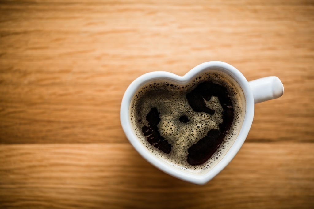 Black coffee, espresso in heart shaped cup. Love concept, Valent